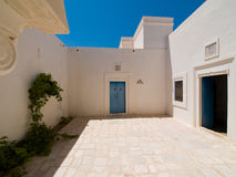 Tunisian house. Typical Tunisian House with blue windows Royalty Free Stock Photography