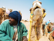 Tunisian man with camel Royalty Free Stock Photo