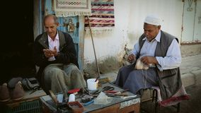 Tunisian men at work. Portrait of artisans in douz, tunisia stock video footage