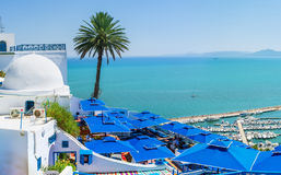 The Tunisian resort. SIDI BOU SAID, TUNISIA - AUGUST 31, 2015: The best view on the sea from the mountain top on the terrace of local restaurant, on August 31 in Stock Photos
