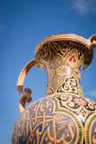 Tunisian Urn. A low angle detail view of a painted Tunisian urn offset against a blue cloudless sky providing copy space Stock Photography