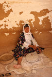 Tunisian woman grinding grains Stock Image