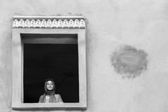 Tunisian woman. A tunisian woman on window Stock Photos