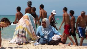 Tunisians on the beach. TUNISIA, SOUSSE, JULY 9, 2010: Tunisian people on the beach in Sousse, Tunisia, July 9, 2010 stock video