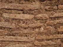 Tunna smala stenar i en vägg Arkivbild