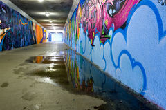 Tunnel. Underground tunnel with graffiti painted walls Royalty Free Stock Photography