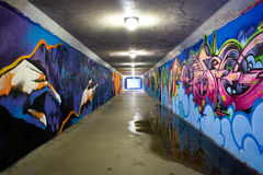 Tunnel. Underground tunnel with graffiti painted walls Stock Image