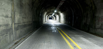 Highway Tunnel Two Lane Road Darkness of Night Stock Images