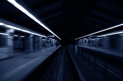 Tunnel. Speedy trains passing train station Stock Photos