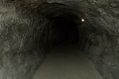 The tunnel. Dark tunnel under the ground Stock Photography