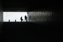 Tunnel. Two men inside tunnel stock photo