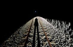 Old abandoned railroad and light at the end of the tunnel royalty free stock image