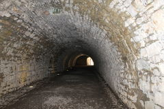 Tunnel. Ancient dark tunnel in Italy Stock Image