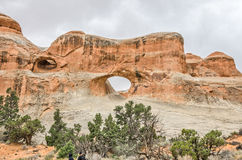 Tunnel Arch. In the Devils Garden area of Arches National Park.  Another, smaller arch is visible to the left Royalty Free Stock Photo