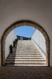 Tunnel arch with ladder from stones. In old bastion Royalty Free Stock Image
