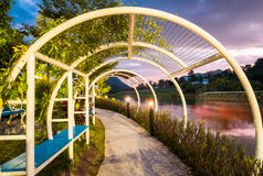 Tunnel arch steel pathway beautiful. At sunset Stock Image