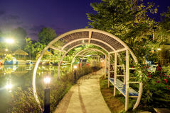 Tunnel arch steel pathway beautiful. At sunset Stock Photo