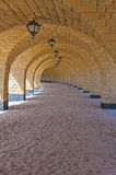 Tunnel of arches on a tropical beach Royalty Free Stock Photography