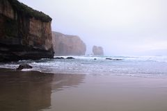 Tunnel beach near Dunedin at early morning fog, South Island, New Zealand stock photography