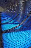 Tunnel of Blue. Curved iron structure illuminated in blue Stock Photos