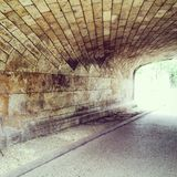 Tunnel bridge brick. Stone Tunnel summer Royalty Free Stock Image