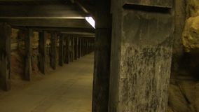 A tunnel with a bright light in the end. A medium shot of a tunnel. Camera moves to the left stock footage