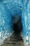 A tunnel carved into a glacier. A galery with vaulted ceiling carved into the Rhone glacier in Switzerland. Along the ceiling condensed breath collects in a Royalty Free Stock Image