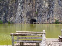 Tunnel carved in stone to give access to the lake on the other side Stock Photos