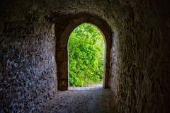 Tunnel through the castle wall into the garden Stock Photos