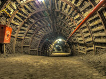 Tunnel. A tunnel in a coal mine leading deep  into the earth Stock Images
