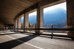 Tunnel with columns in mountains Stock Image