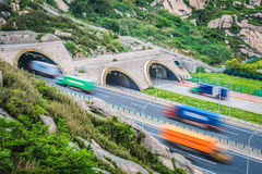Tunnel with container trucks Stock Photo