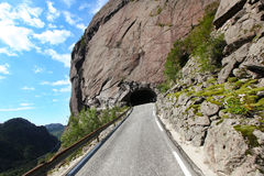 Tunnel cut into mountain, road pass Royalty Free Stock Photos