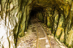 Tunnel in disused mine with rails Stock Images