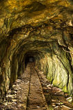 Tunnel in disused mine with rails Royalty Free Stock Images