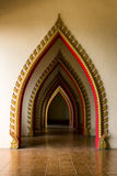 Tunnel door in the thai church at Thailand. It has a multi tunnel door in the thai church at Thailand royalty free stock image