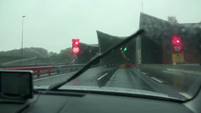 Tunnel drive on a highway. Driving on a highway on a misty and rainy day shot in slow motion stock footage