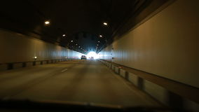 Tunnel drive, Traffic in the road tunnel, cars go through the tunnel stock video footage