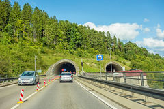 Tunnel entrance / exit with cars, highway Stock Photos