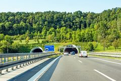 Tunnel entrance / exit with cars, highway Stock Photo