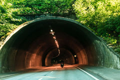 Tunnel entrance and vehicles in Norway Stock Photo