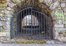 Tunnel entry acces locked with metal gates Stock Image