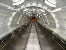 A tunnel with an escalator,. This tunnel with an escalator is located inside the Atomioum building in Brussels stock image