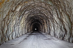 Tunnel excavated in the Apuan mountains, crossover concept Stock Photo