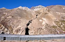 Tunnel and fails on the andes mountain withs a clear sky royalty free stock photo