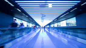 Tunnel with flat escalators in airport of Seoul Stock Photography