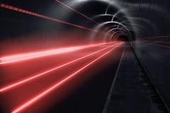 Tunnel foncé avec les journaux légers Photos libres de droits