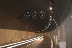 Tunnel on a freeway. Car lights trails in a tunnel Stock Photos