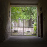 Tunnel and gates to the yard Royalty Free Stock Images