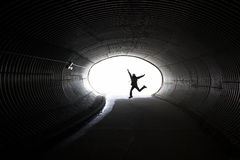 Tunnel and girl in motion Stock Photo